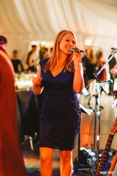 Kelly, MCing a wedding at Lake Pearl in Wrentham, MA. Photo by Piquant Photography: https://www.piqu