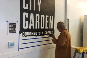 Hand painting, or hand lettering, and interior wall sign. Artist John Ton.
