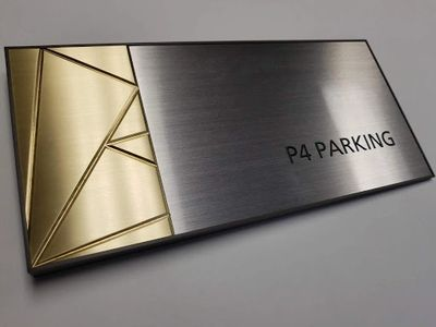 High rise parking sign with brushed aluminum and brushed bronze finishes
