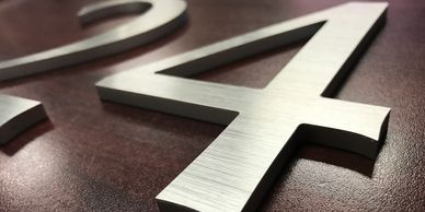 Router cut brushed aluminum numbers for indoor or outdoor signage