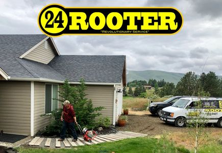 24 rooter of yakima plumbing company with drain cleaning machine at residential customer's home