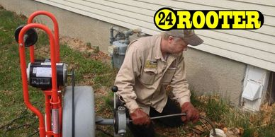 Yakima plumbers using a sewer drain cleaning machine to remove roots in plumbing pipes