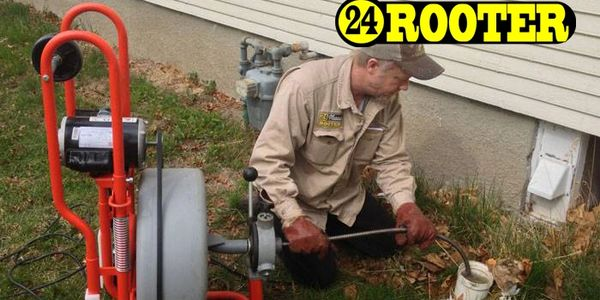 Yakima Sewer cleaning service plumber snaking a main sewer