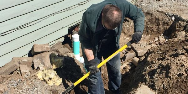 Photo of 24 rooter plumber installing a sewer cleanout