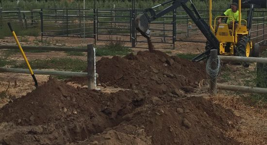 Irrigation trenching with Plumber on backhoe 24 rooter Plumbing