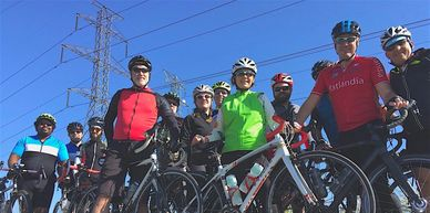 A group of cyclists smiling at the camera.