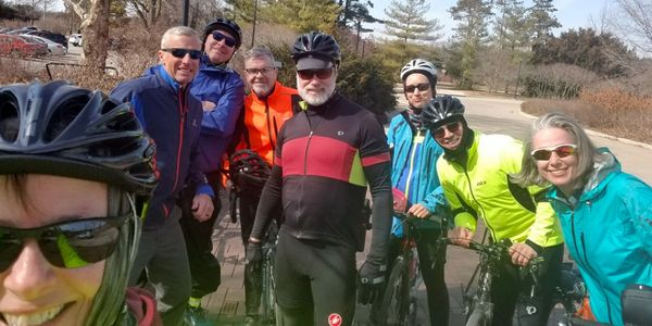 Eight cyclists in winter cycling clothing.