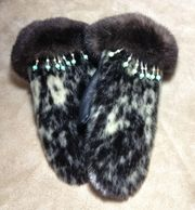 Seal and sea otter cuff mittens with fancy earth tone beads.