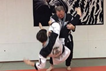 A Mixed Martial Art allows for techniques from many schools. Here is a Hapkid move executed by Master Garrison on Alan Corbin for demonstration purposes.