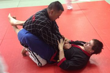 Matt Stauner demonstrates the front guard position with Dean Corbins assistance.