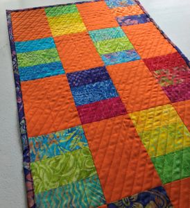 Straight-line quilting and runner made from scrap fabric.