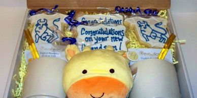 Tea and cookies with a baby toy were sent to a Merrill Lynch client to congratulate them on their new baby.