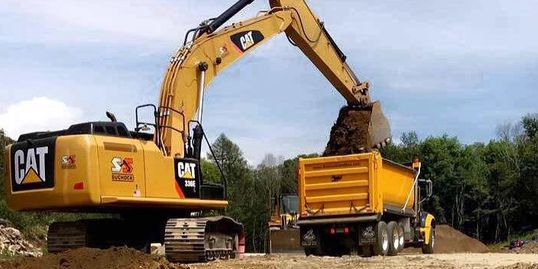 Excavator loading Tri-Axle with Screened Loam