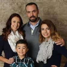 Pastor Ryan Jacobs, his wife Sarah, daughter Madison, and son Zenon