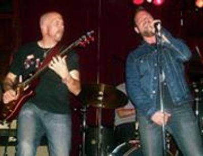 "Chris Van Duyn & Johnny Rossa give ""...strong vocal delivery and first rate guitar work..."""