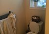 Before, Low toilet, no solid place to mount grab bars