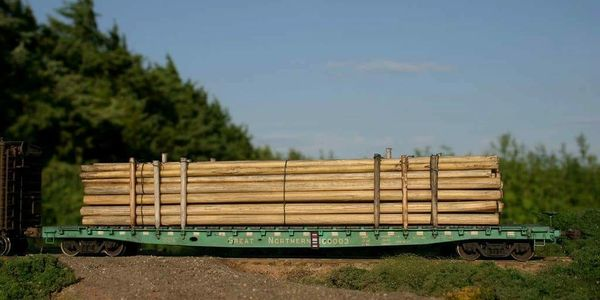 Custom Handlaid telephone poles for flatcar load.
