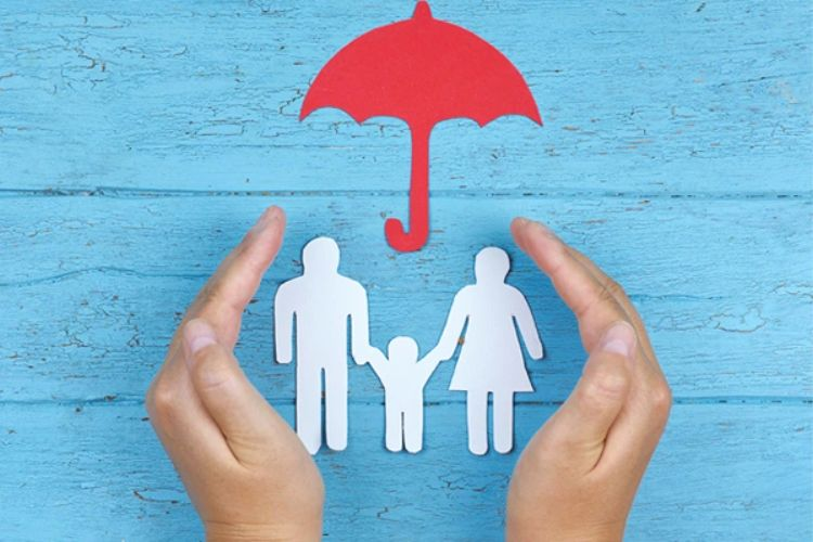 umbrella protecting a family