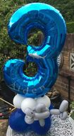 Age balloons Helium or Airfilled. This one has a twisted shark and is personalised,