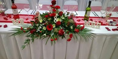 Top table arrangement in your colour scheme, table posies and brides flowers can also be arranged