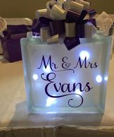 Twinkle light boxes personalised with your message, or name for your top table. Lights included.