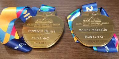 Onsite Engraving Service, NYC Marathon personalized engraved medals.