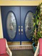 Residential front doors with handle sets and kick plates installed