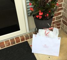 a gift bag of cheesecakes delivered to someone's front door in Jonesboro, GA