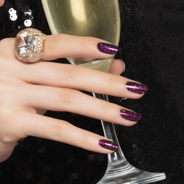 Color Street Nails come in Solids, Glitters, and Nail Art designs.  Shown is Bordeaux Glitz.