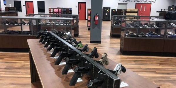 Try before you buy guns on retail display