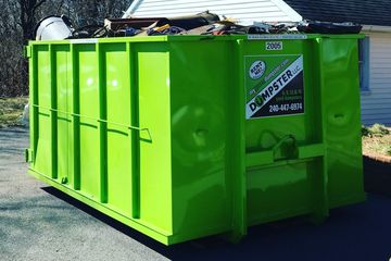 20yard green dumpster for large garage clean out!