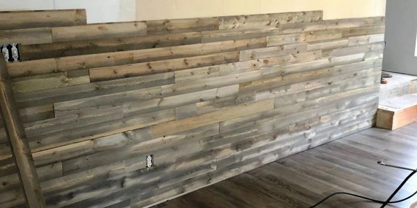 accent wall with dark weathered boards