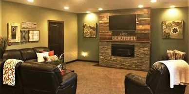 Cozy basement remodel with tv over fireplace recessed lighting