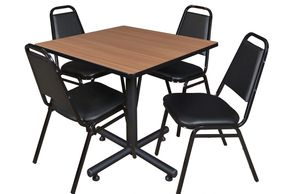 Chairs and a table similar to what might be seen in an office break room or lunch area.