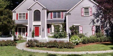 Exterior paint job with painted fence, windows and trim, door