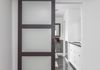 Brendonwood - Complete home remodel / frosted barn-wood door to master bathroom