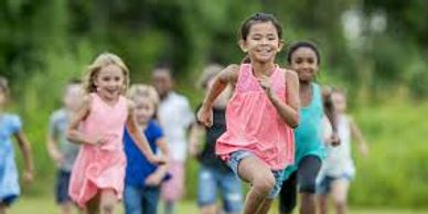Children running outside in nature getting exercise.