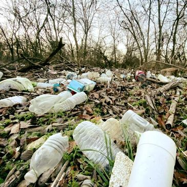 Thousands of pounds of plastic lay suffocating Fish Creek, the creek banks and wooded area by trail.
