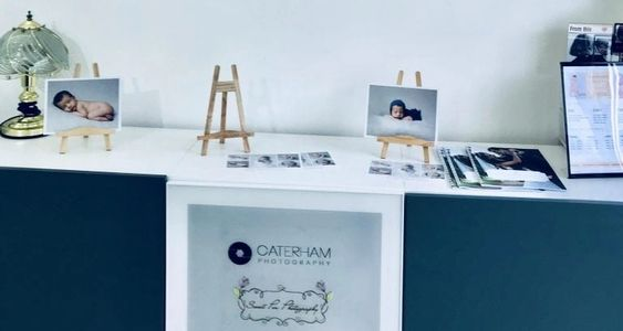 Caterham Photography Print Shop, Photo Canvas Display in Photo Shop, Photo Stands on Counter