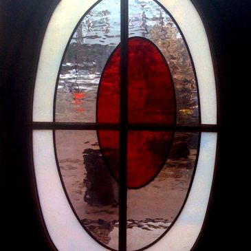 "The ""Sunny Side-up"" a custom stained glass window."