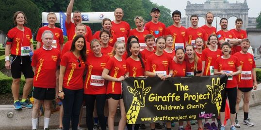 Giraffe runners before the 2016 Brussels 20k