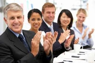 Business people clapping on page of Testimonials