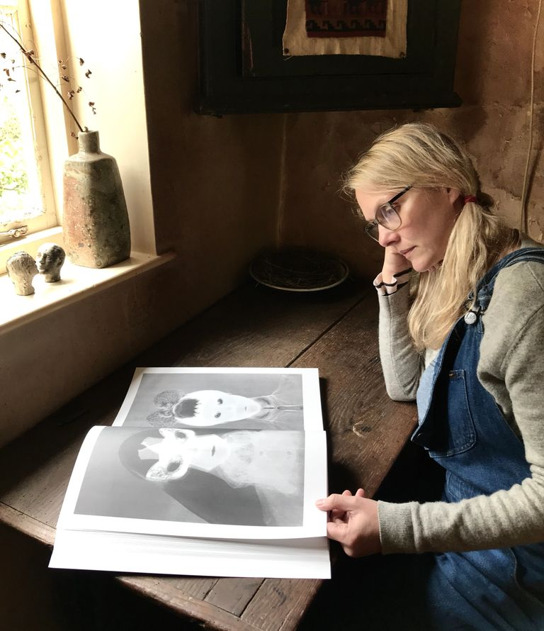 "Maria Riese looking at 'Phantom Folk"" photo story published in Pan & The Dream magazine"