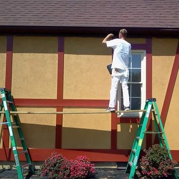 (Painter) James Putting The Finally Touchs On This Big Exterior Painting Job.  Exterior & Interior Painting Services Tri Cities Paint Pros
