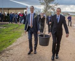 Mayor of Akka, and David Rutstein carry an olive tree during ceremony.