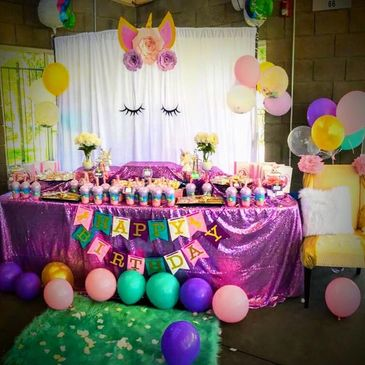 Unicorn themed candy and dessert table.