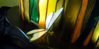 3D dragon fly at the base of a sculptural lamp. Custom metal and stained glass  with fused details