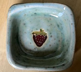 Turquoise square dish with strawberry pattern