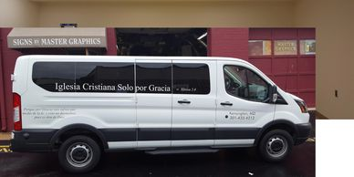 Church Vans lettered cheaply.