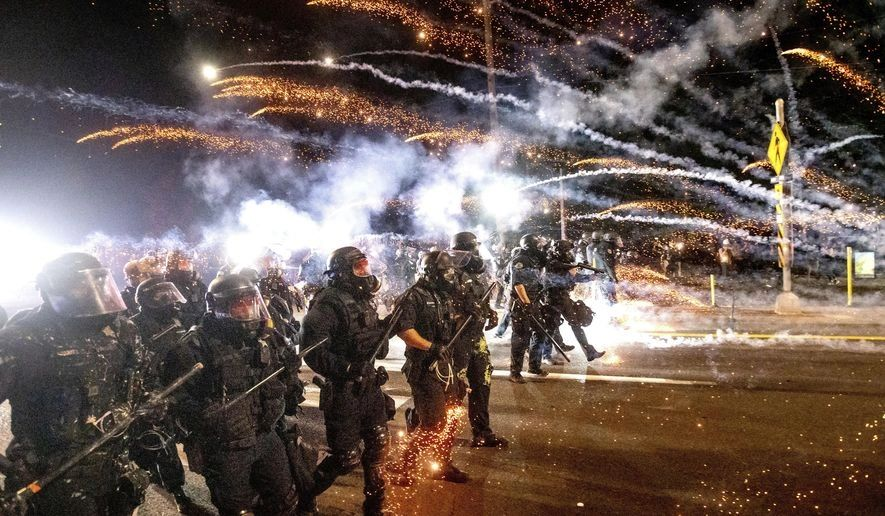 The feds call for peace after the entire police protest unit resigned